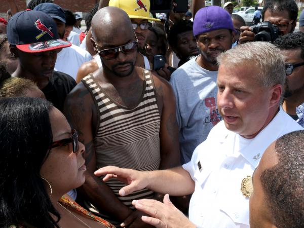 St. Louis Police Chief Sam Dotson talks to a crowd about the shooting Tuesday.