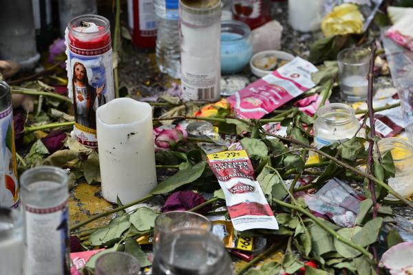 A memorial sits at the site of Michael Brown's death in Ferguson, Mo. Any investigation into his shooting by a police officer is likely to take months.