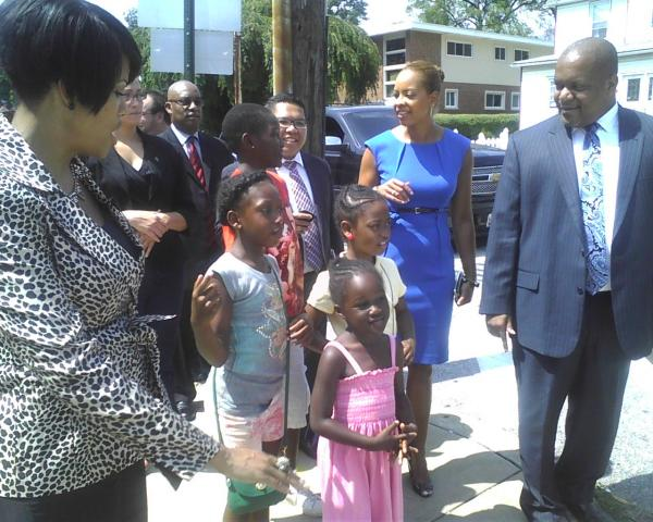 Mayor Stephanie Rawings-Blake (far left), William Johnson, Baltimore's transportation director (far right) and Arlington Elementary/Middle School principal Emily Hunter (second from right) lead students along the school's designated safe route.
