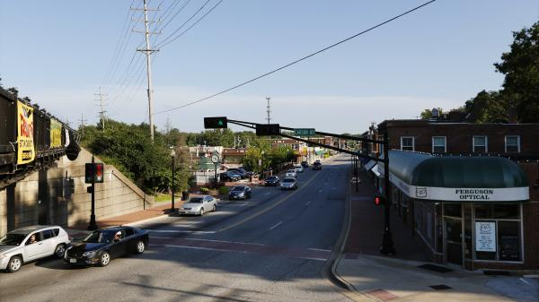 Cars pass through downtown Ferguson along North Florissant Avenue, about 4 miles away from where major protests and rioting took place. This stretch is seeing some reinvestment — like some some new city buildings — but there are signs that it has its own economic challenges.