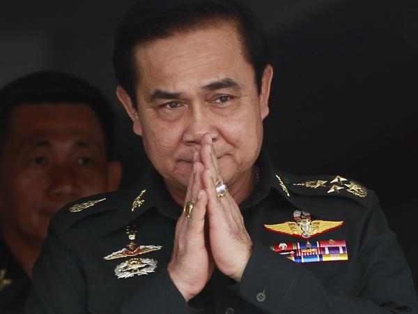 Thailand's newly appointed Prime Minister Prayuth Chan-ocha gestures in a traditional greeting during his visit to a unit of the Queen's Guard outside Bangkok on Thursday.