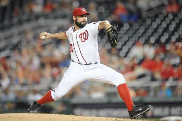 Tanner Roark #57 of the Washington Nationals pitches in the third inning during a baseball game against the Arizona Diamondbacks on August 20, 2014 at Nationals Park in Washington, DC. (Mitchell Layton/Getty Images)