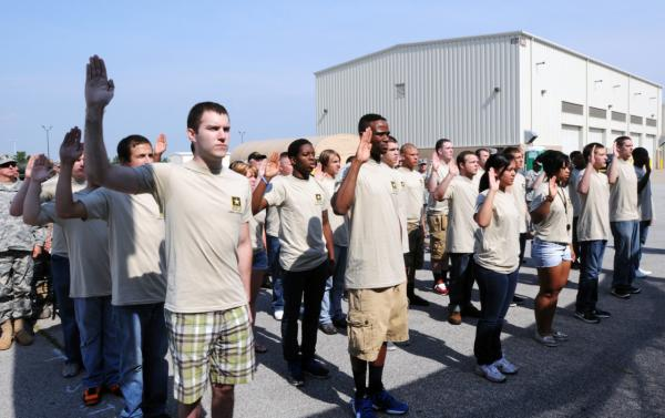 New recruits swear in during the Army Reserve Mega Event in Whitehall, Ohio, June 22, 2013. (Andrew Baba/U.S. Army)