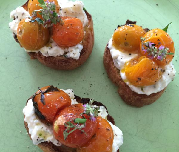 Ricotta toasts with slow-roasted tomatoes. (Kathy Gunst/Here & Now)