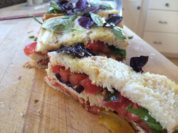 "Mary Ann Esposito's ""Tomato Sandwich My Way"" is made in a bread pan and serves eight people. (Kathy Gunst/Here & Now)"