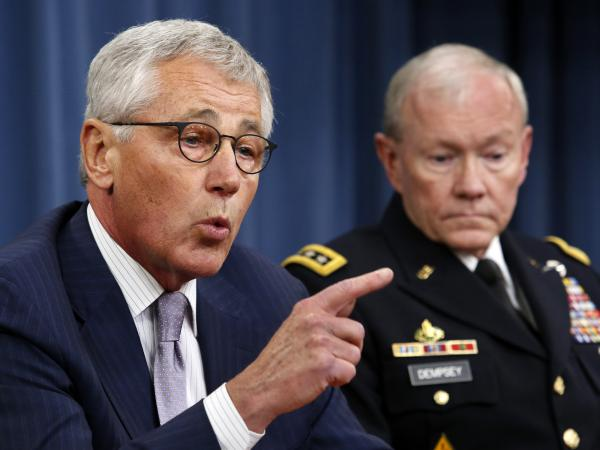"Secretary of Defense Chuck Hagel (left) and Chairman of the Joint Chiefs of Staff Gen. Martin Dempsey during a Pentagon briefing on Thursday. Hagel said Islamic State militants in Iraq and Syria posed a threat ""beyond anything we've seen."""