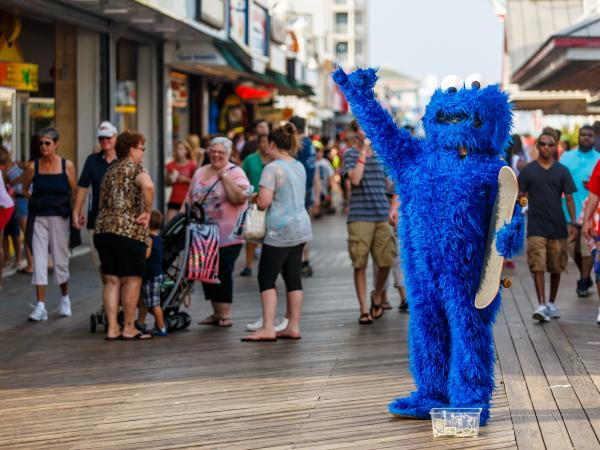 A Cookie Monster is one of many costumed performers on the boardwalk in Ocean City, Md., this summer. Kids can pose for a photo with them, and then their parents are expected to leave a tip.