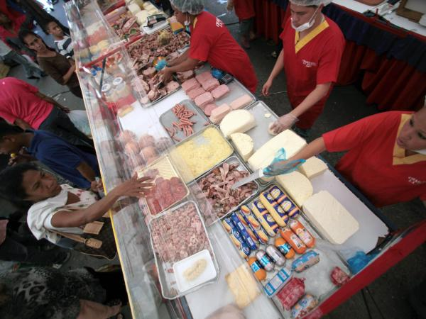 Government-subsidized goods at a state-run market in Caracas, Venezuela, in 2012. Smuggling of cheap groceries into neighboring Colombia is so rampant that the government plans to fingerprint shoppers.