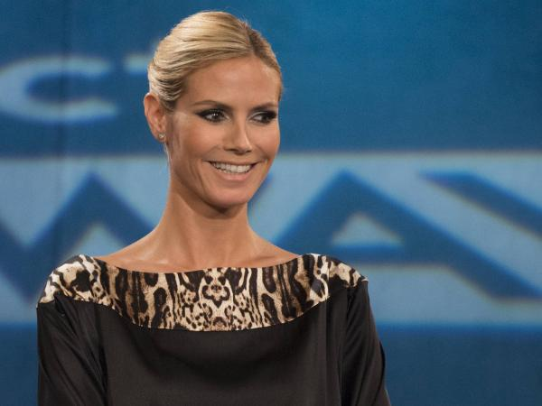 Heidi Klum remains with <em>Project Runway</em>, where she's been since it began.