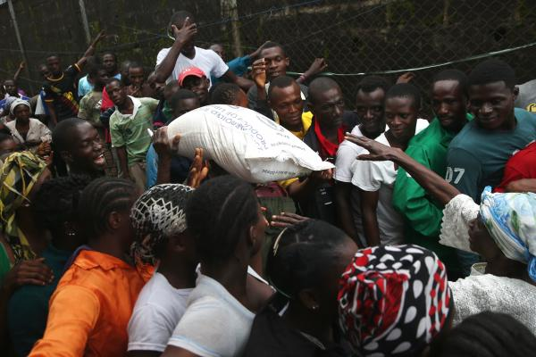 The Liberian government delivered bags of rice, beans and cooking oil to residents of the West Point slum in Monrovia. The community has been quarantined because of the Ebola outbreak in the area.