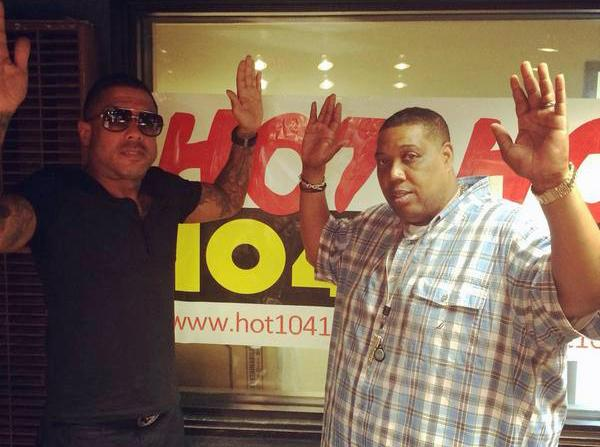 "Radio station Hot 104.1 St. Louis tweeted this photo of DJ Boogie D (right) and record producer Benzino making the ""hands up don't shoot"" pose. (Twitter)"