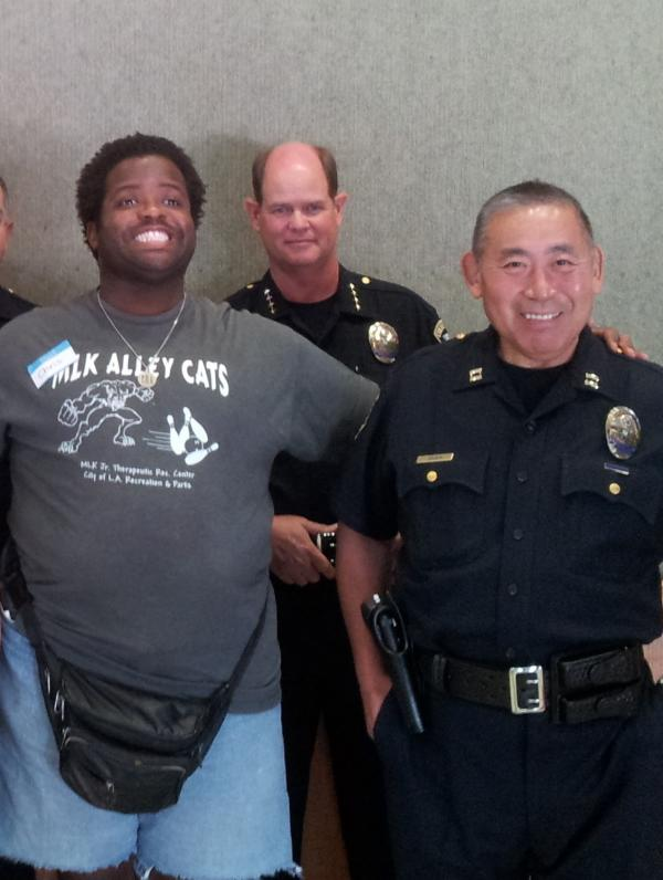 Chris Akubuilo meets members of the Culver City, Calif., police department. Akubuilo has autism, and his mother is worried about his safety when he interacts with police.