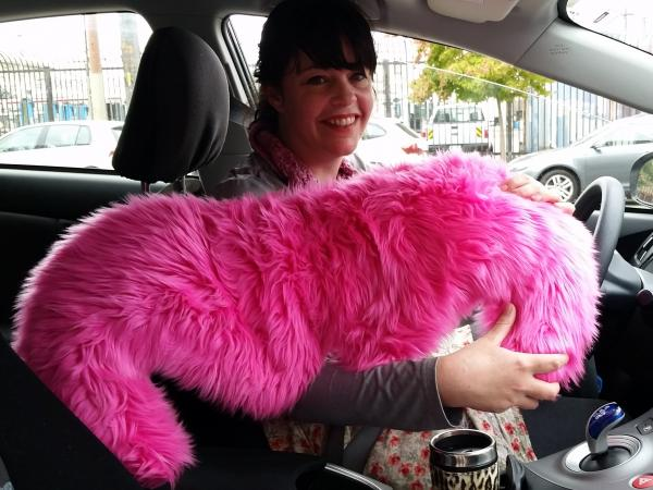 Lyft driver Danielle Kerley showcases the company's iconic mustache, which is displayed on cars used in the service.