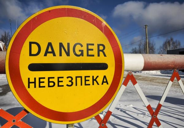 A sign warns of high radiation levels in the Chernobyl Exclusion Zone. (Trey Ratcliff/Flickr)