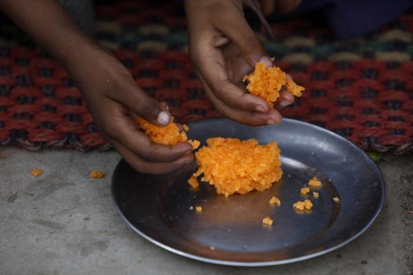 Sweetened rice is a popular dessert and snack in India. This dish, traditionally made with a pinch of saffron and cardamom powder, was served at a school on the outskirts of Jammu in northern India.