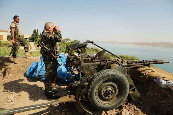 Kurdish forces, known as peshmerga, stand guard near the Mosul Dam on Aug. 17. U.S. airstrikes against the Islamic State allowed the peshmerga to move in and take the area around the dam recently.
