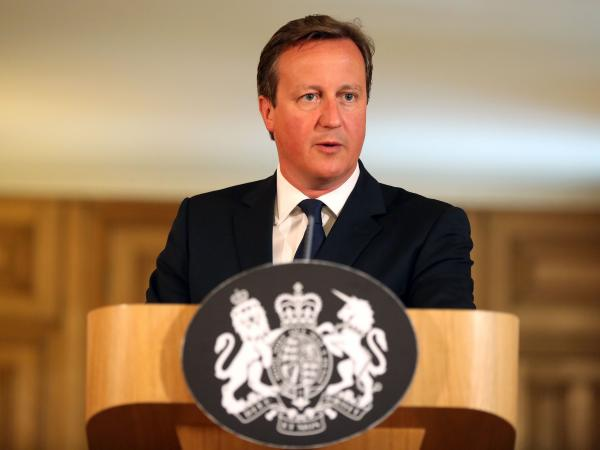 Britain's Prime Minister David Cameron speaks at a news conference in London on Friday after the U.K. raised its terror alert level.