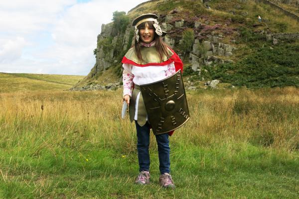 Alisha Martin, 9, visits Hadrian's Wall in a Roman costume.