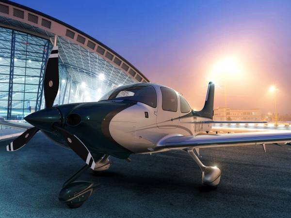 A Cirrus SR22 similar to this one ran out of fuel and crashed into the Atlantic after its pilot apparently fell unconscious.