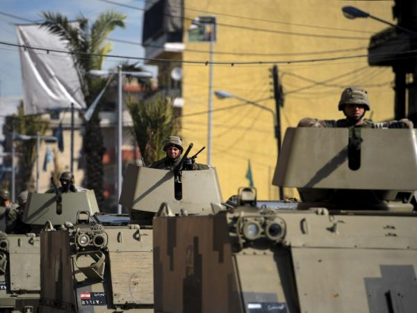 Lebanese soldiers patrol in the northern city of Tripoli on Sunday, Feb. 12, following clashes between Lebanese Sunni Muslims, who oppose Syria's regime, and Alawites, who support it. The rival Lebanese factions fired guns and rocket-propelled grenades at each other last week, killing three people.