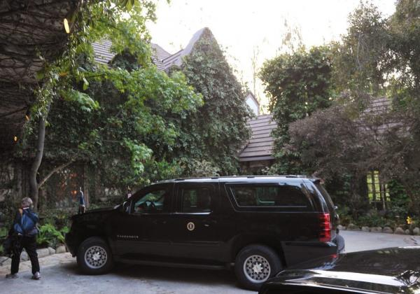 A presidential SUV is seen outside of the house of actor George Clooney on Thursday in Los Angeles.