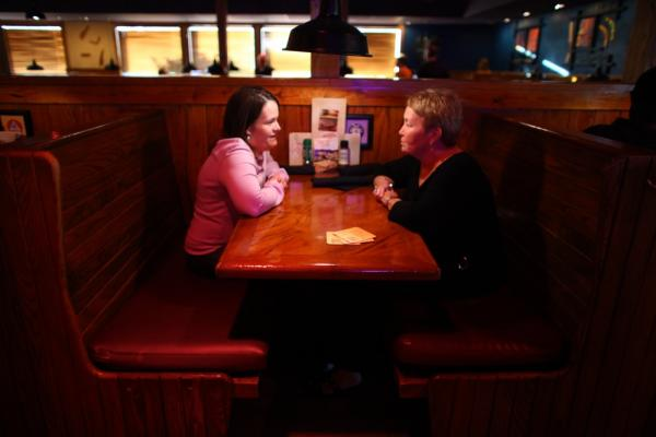 Beckett (left) and her mom Julie go to a restaurant in Cedar Rapids, Iowa, once a week to catch up. Beckett is now famous among children's advocates and travels the country with her mom working for laws and programs in favor of homecare.