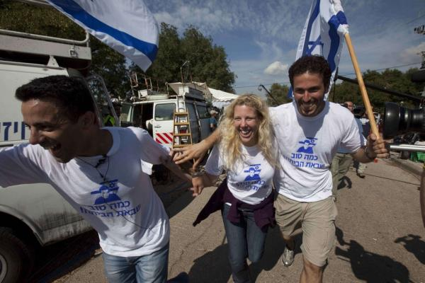 Supporters of Shalit celebrate in Mitzpe Hila. The Israeli tank crewman was captured in 2006 during a cross-border raid by Palestinian militants.