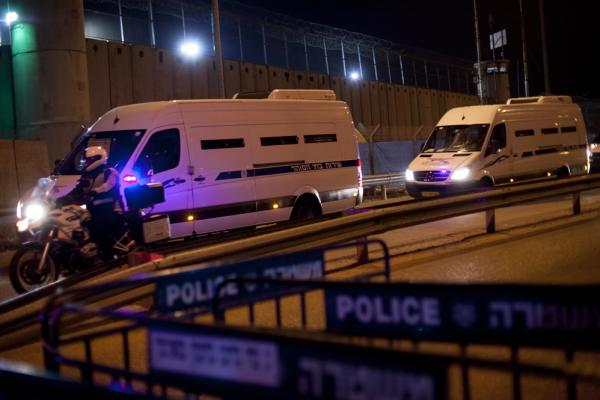 A convoy of Israeli Prison Service buses arrives at Israel's Ofer prison in the early morning hours to transport Palestinians prisoners.