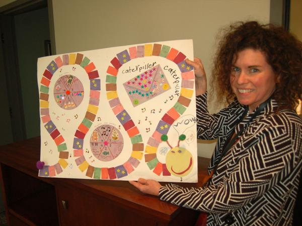 Eva Kennedy's mom shows off her homemade practice game.