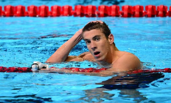 Michael Phelps reacts after winning the men's 200m Butterfly semifinal on day six of the 2012 U.S. Olympic Team Trials on Saturday.