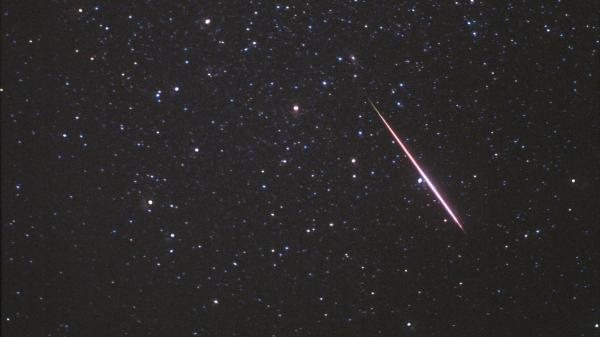 In this photo released by SkyandTelescope.com, a Perseid meteor flashes across the constellation Andromeda on Aug. 12, 1997.