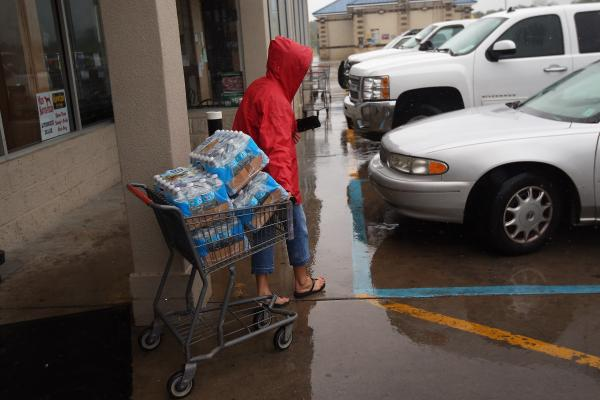 Suzette Necaise stocks up on bottled water at Seal's Marketplace Kiln, Miss. The area suffered severe damage during Hurricane Katrina in 2005.