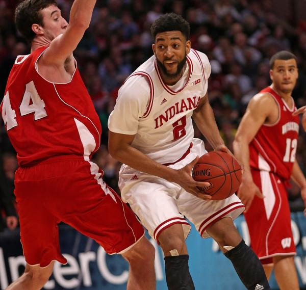 Christian Watford of the Indiana Hoosiers moves against Frank Kaminsky of the Wisconsin Badgers during a semifinal game of the Big Ten Basketball Tournament at the United Center on March 16, 2013.