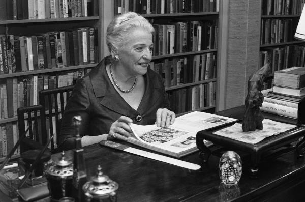 At her desk in the study of her Philadelphia townhouse in 1967, Pearl Buck looks at a bound volume of the magazine <em>Asia </em>from 1925 that<em> </em> contained her first published work.