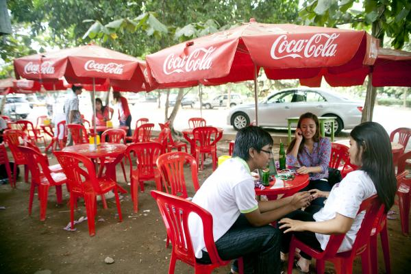 Customers enjoy an afternoon snack and drink at a tea shop near a Myanmar television station in Yangon.