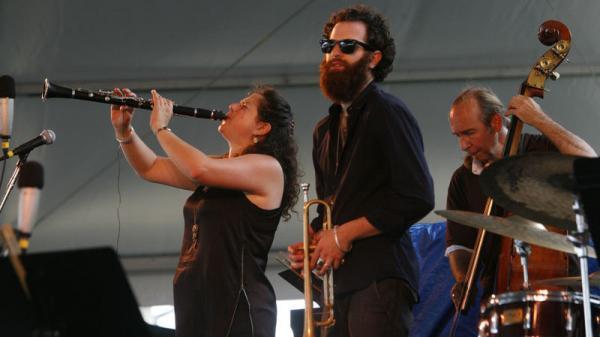 Anat Cohen (left) performs with Avishai Cohen (center) at the Newport Jazz Festival.