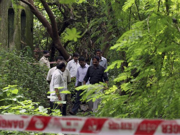Police officers on Friday inspect the site where a woman in her early 20s was allegedly gang raped in Mumbai, India.