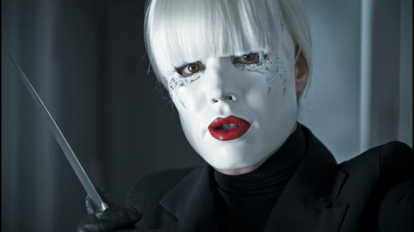 Is that Noomi Rapace's Isabelle behind the mask (and the knife)? Could be. Probably is. <em>Passion</em> is nothing if not a genre flick — though genre films do come with their twists.