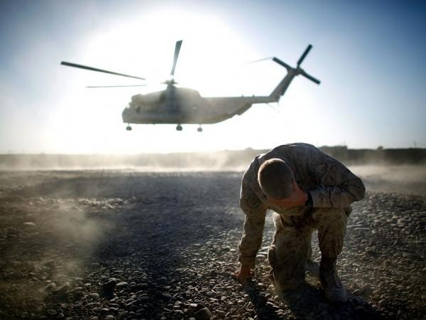"A U.S. military helicopter takes off in southern Afghanistan. They may still be called ""choppers"" in the movies, but troops universally refer to them as ""birds."""