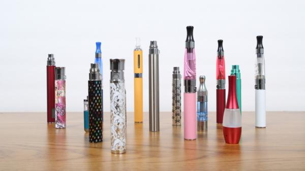 Some employees say e-cigarettes increase their productivity and help them steer clear of tobacco. But health regulators are looking into possible risks to e-cig users — and to co-workers.