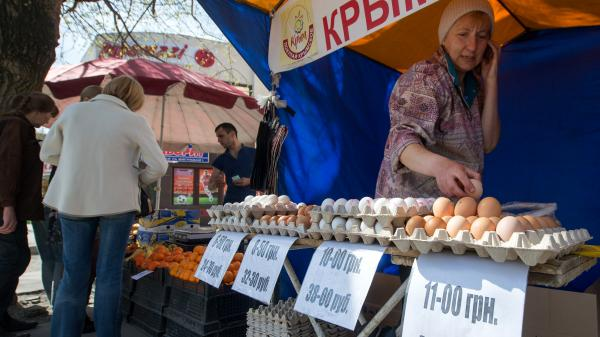 A street vendor in Simferopol, Crimea, sells eggs with the dual currency price tags in Russian rubles and Ukrainian hryvnias. Russia's annexation of Crimea mean it will now have to prop up the peninsula's weak economy.