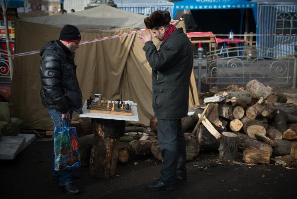 Two men play chess in Kiev's Independence Square on Feb. 11. Ukraine's economy is ailing, and the country is facing austerity measures in exchange for an IMF loan. Meanwhile, Russia says it will sharply increase gas prices.