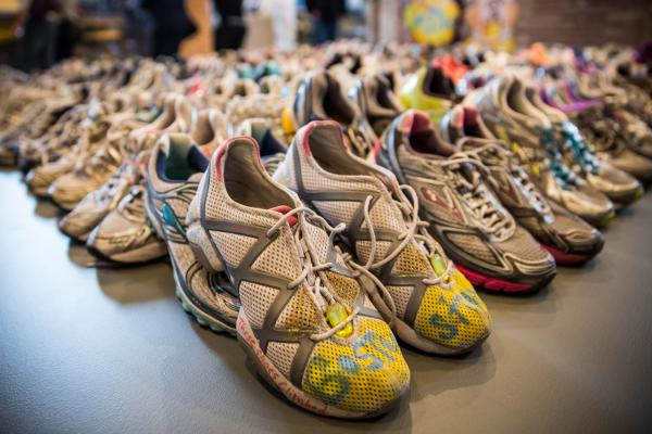 Runner's shoes are laid out in a display titled, 'Dear Boston: Messages from the Marathon Memorial' in the Boston Public Library to commemorate the 2013 Boston Maraton bombings, on April 14, 2014 in Boston, Massachusetts. (Andrew Burton/Getty Images)