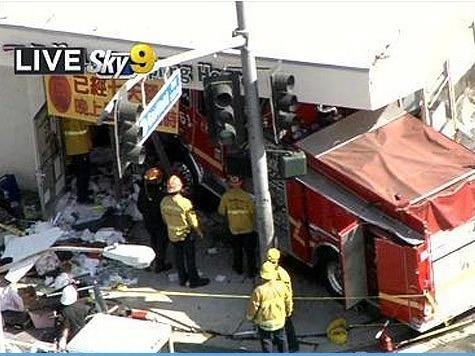 A screen grab from CBS Los Angeles shows a firetruck after it smashed through the front of Lu's Dumpling House.