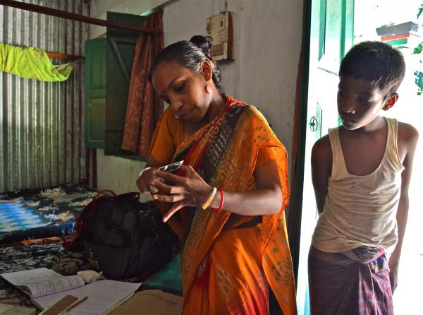 A community health worker conducts a home visit in 2013 with an expectant mother in Sylhet, Bangladesh, to screen for infections that have been linked to premature birth.