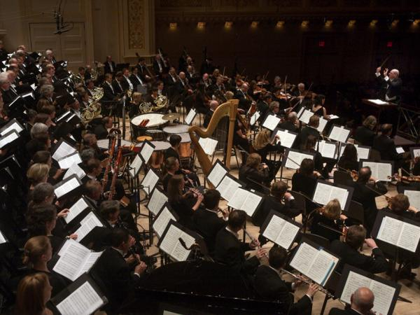 Every inch of the immense Carnegie Hall was filled with musicians as music director Robert Spano leads his Atlanta Symphony Orchestra and Chorus in Benjamin Britten's stunning <em>War Requiem</em>.