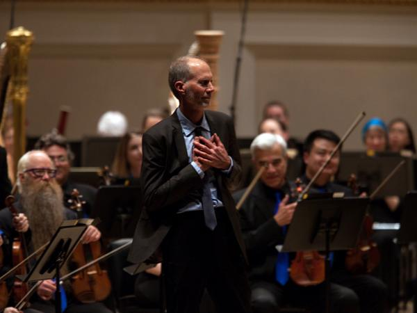 Composer John Luther Adams accepts enthusiastic applause from the Carnegie Hall audience after the New York premiere of his 2014 Pulitzer Prize-winning piece, <em>Become Ocean</em>, performed by the Seattle Symphony Orchestra.
