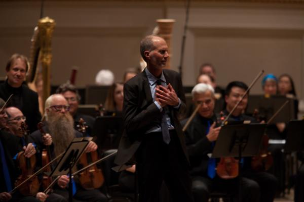 The composer John Luther Adams, whose music is often inspired by the natural world, accepts the enthusiastic applause from the Carnegie Hall Audience after the Seattle Symphony performance of his Pulitzer-winning piece <em>Become Ocean</em>.