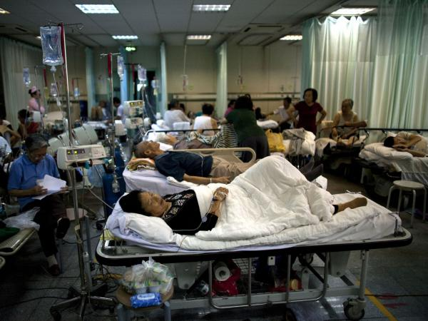 Patients who had suffered heart attacks rest while being observed in the emergency room of a heart hospital in Beijing in 2011.