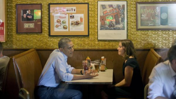 President Obama sits down to have lunch with Rebekah Erler at Matt's Bar in Minneapolis on Thursday. Obama spent a day with Erler, who wrote the White House about her struggles to make ends meet.